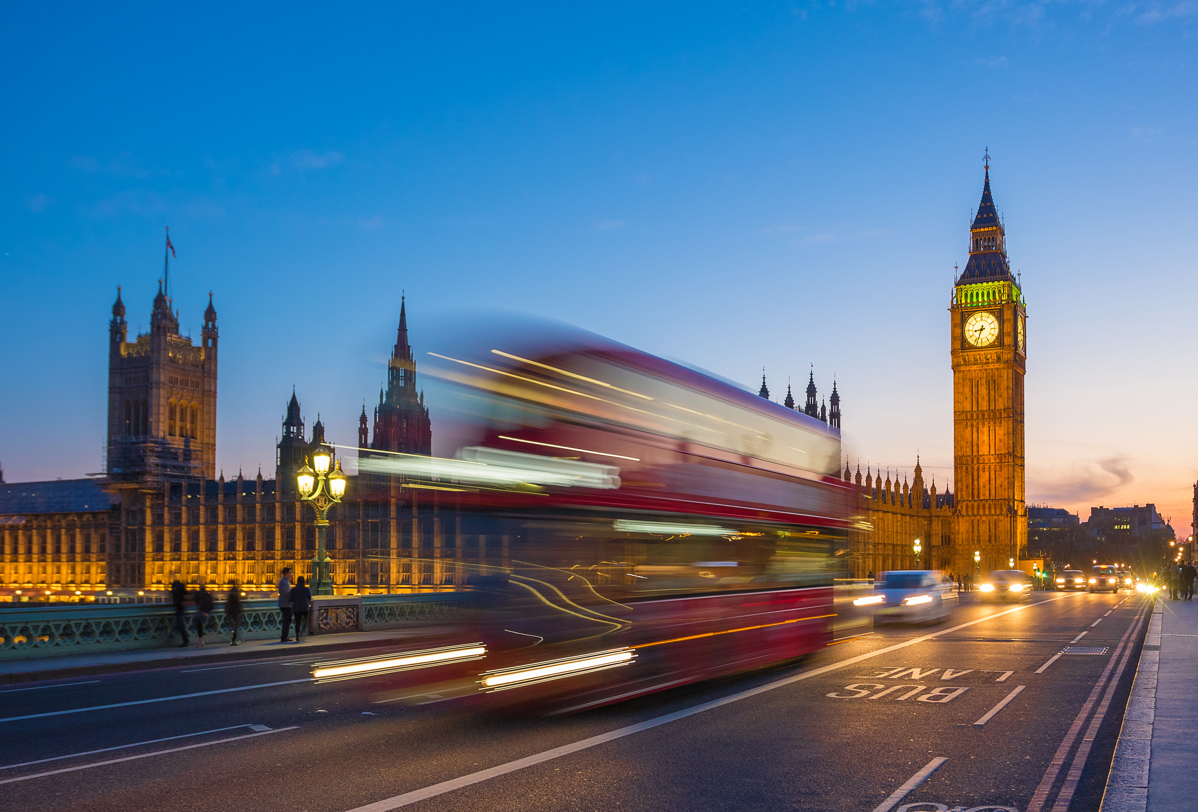 Iconic Double Decker bus with Big Ben and Parliament at blue hour, London, UK